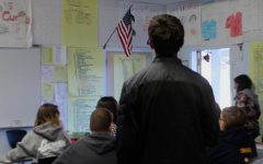Students take a seat during morning pledge