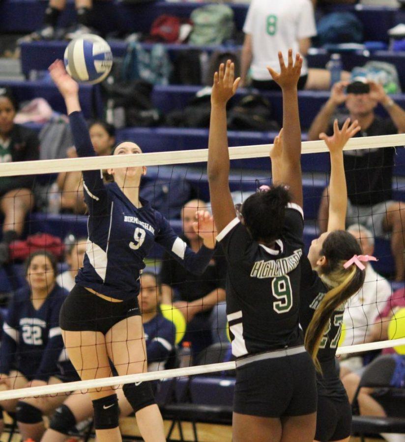 Junior Hailey Kessler attempts a hit against the opposing team's defense.