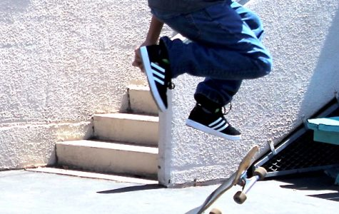 Junior does a kick flip