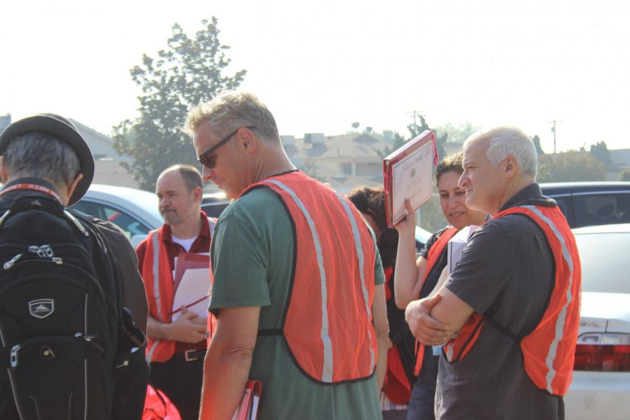 Teachers, who are part of the search and rescue team, gather before walking through classrooms making sure everyone got outside safely.