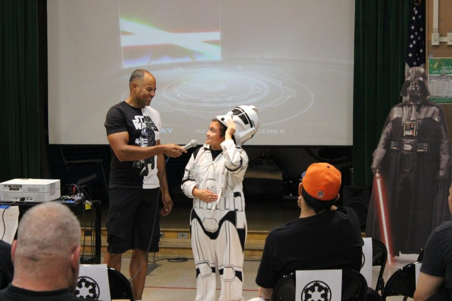 Parent Teacher Student Association (PTSA) President Brandon Jarrett, asks student Hermelinda Sendin about her stormtrooper outfit. A Star Wars costume contest was held at Daniel Pearl High schools first Sci-Fi Friday Movie night on Oct. 13.