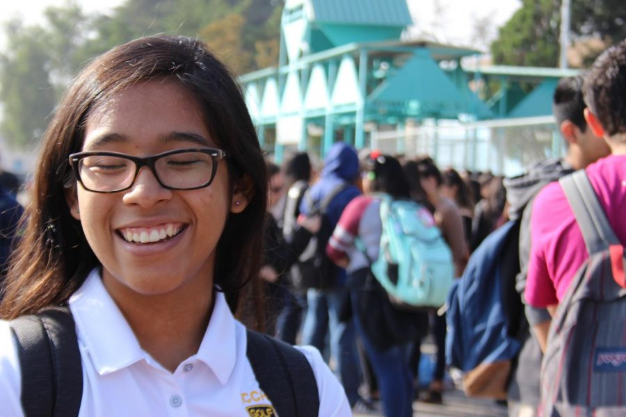 Junior Astrid Cabrera laughs with her friends during the Great California ShakeOut today.