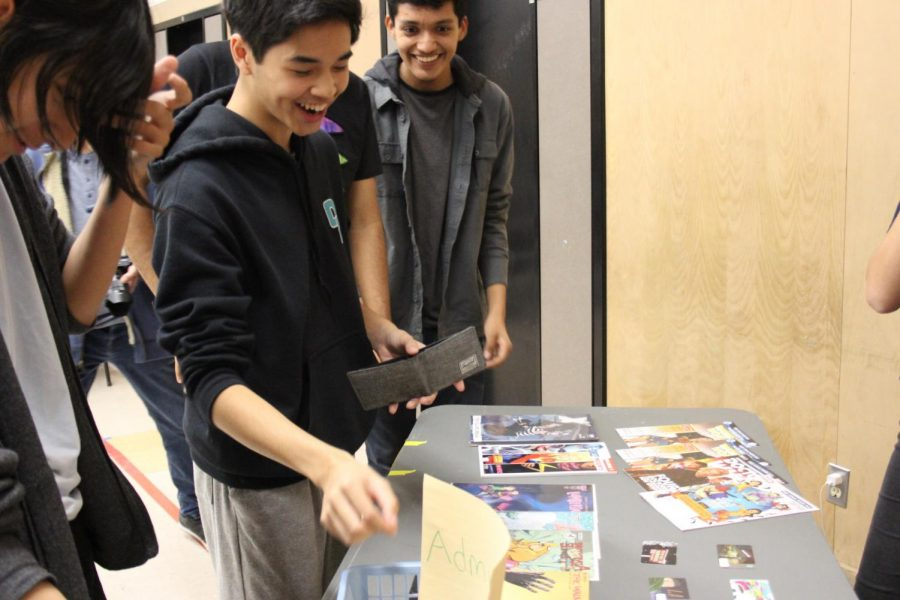 David Mallari putting in the first dollar in the admission fee box at Kahoot! night.