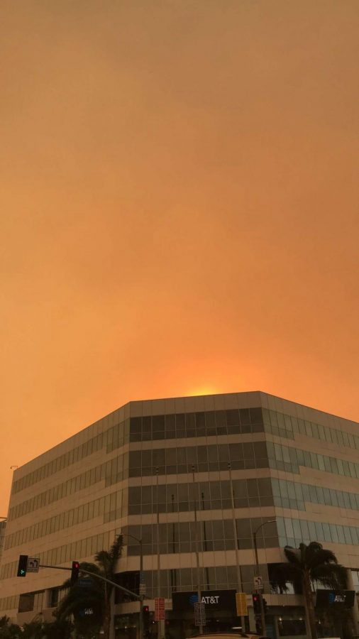 Powerful wind brought the smoke from surrounding wildfires to the valley, resulting in unhealthy and dangerous air quality. The sky at the intersection of Roscoe and Van Nuys boulevards is orange from wildfires in December 2017.