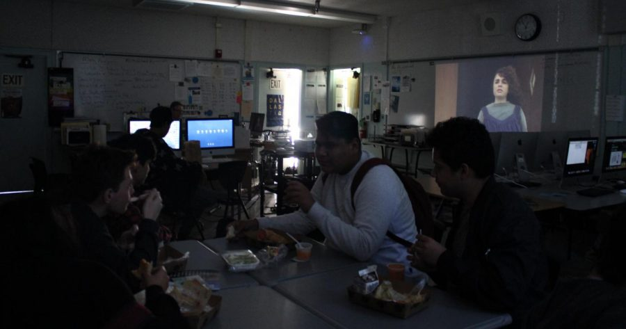 Students gather in Room 9 to watch and discuss classic movies in Motion Picture Club.