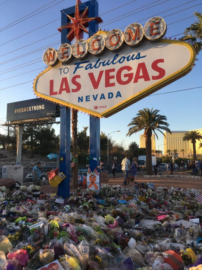 The famous Las Vegas sign was decorated with flowers and other objects as a display of support to the victims of the Oct. 1 mass shooting.