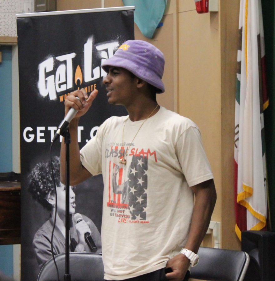 Get Lit performer Khamal Iwuanyanwu recites his original poem to students on Nov. 30 during fourth period.