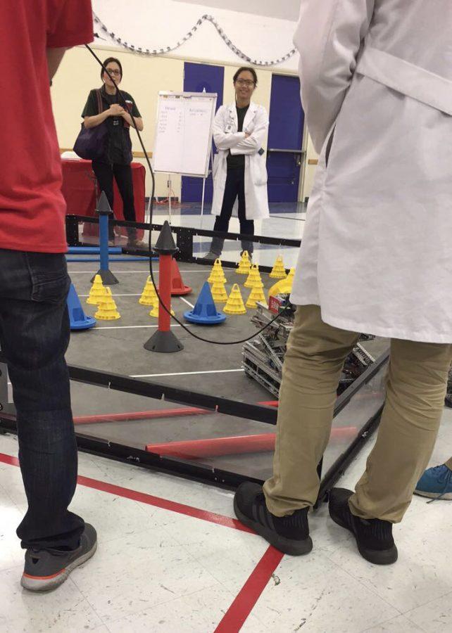 Nikita Opel and Ethan Guttman represented Daniel Pearl Magnet High School in an intense robotics competition.