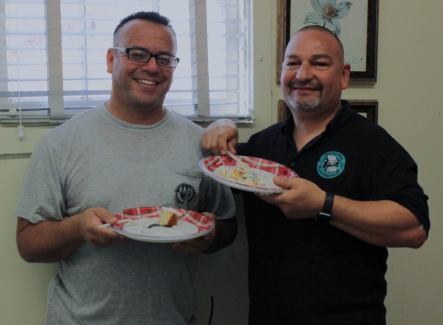 Custodian Juan Amezcua and Plant Manager Sal Rivas enjoy cake in celebration of Amezcua's nomination for California Classified School Employee of the Year.