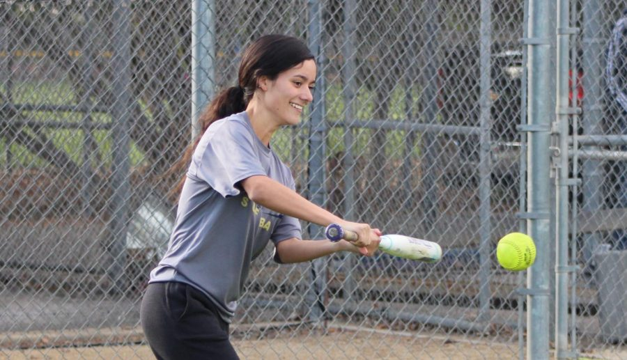 Junior Genevieve Avalos practices batting after school during practice on March 1.