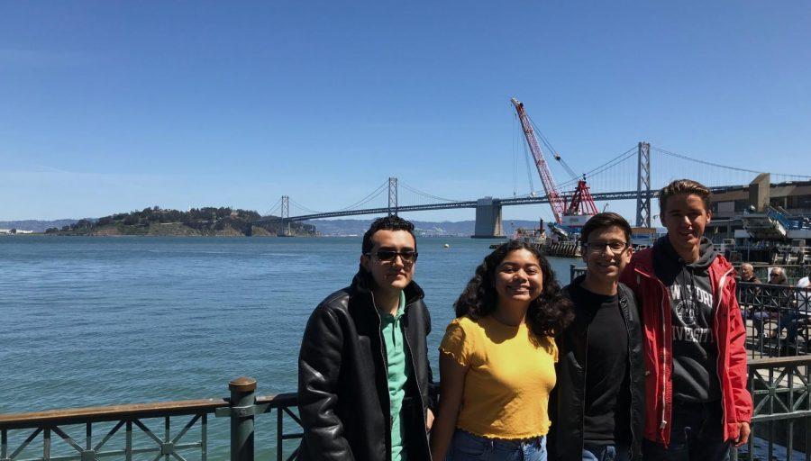 New Media Editor Steven Guzman, Opinion Editor Kirsten Cintigo, Yearbook Design Editor Michael Chidbachian and Yearbook Editor-in-Chief Zachary Gephart-Canada pose together in front of San Francisco's Bay Bridge.