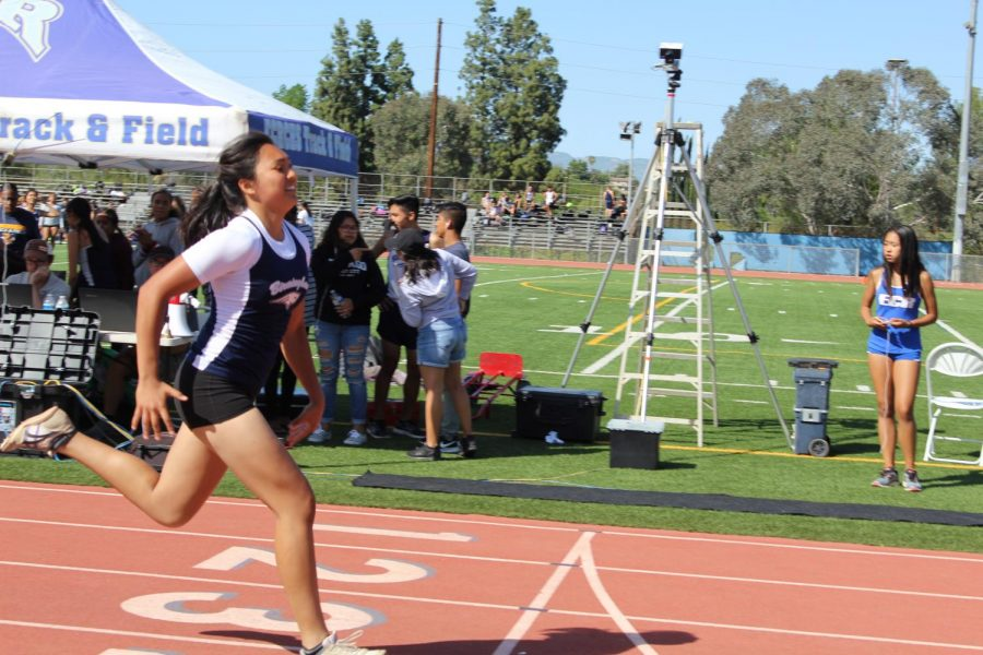 Sophomore Keona Paniagua approaches the finish line during a track meet at Birmingham Community Charter High School.