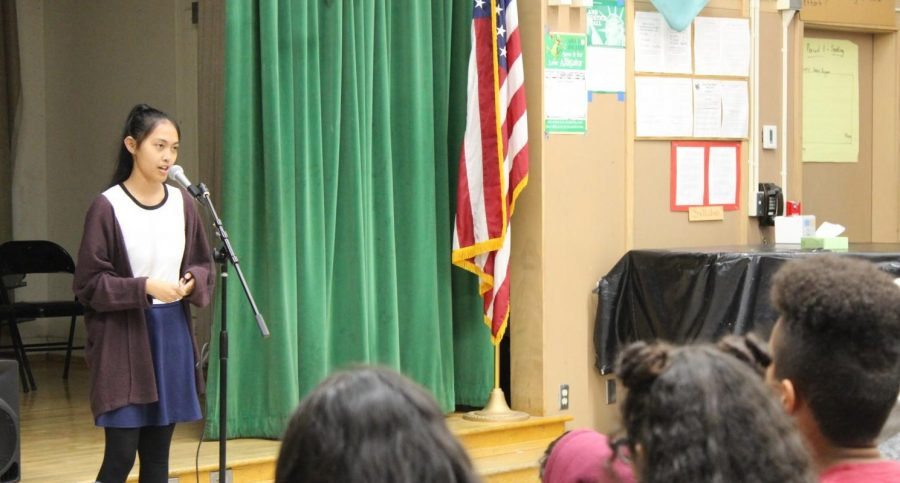 Get Lit players sophomore Andionne Mendoza recites a poems during the April 12 Poetry Slam assembly.