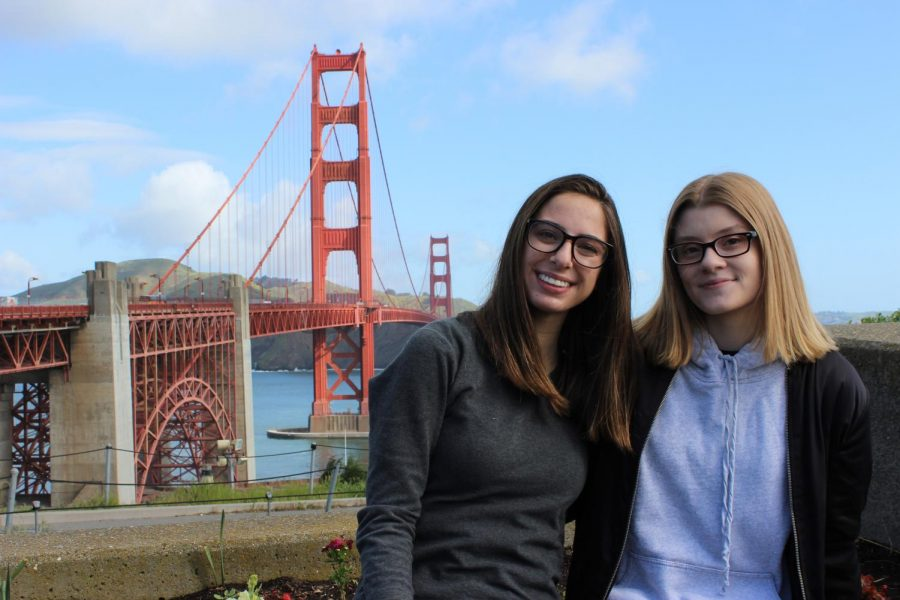 Yearbook Design Editors Eva Kaganovsky and Alice Curran pose together in front of the Golden Gate Bridge.