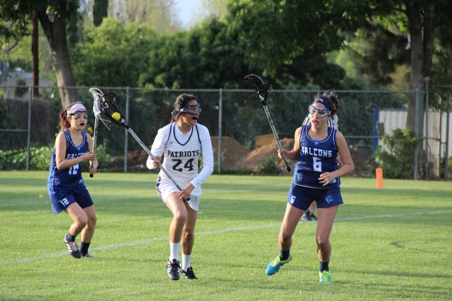 Defender Maria Ruiz out runs the two players from Crescenta Valley High School during a match on April 6. The Patriots won 11-10.
