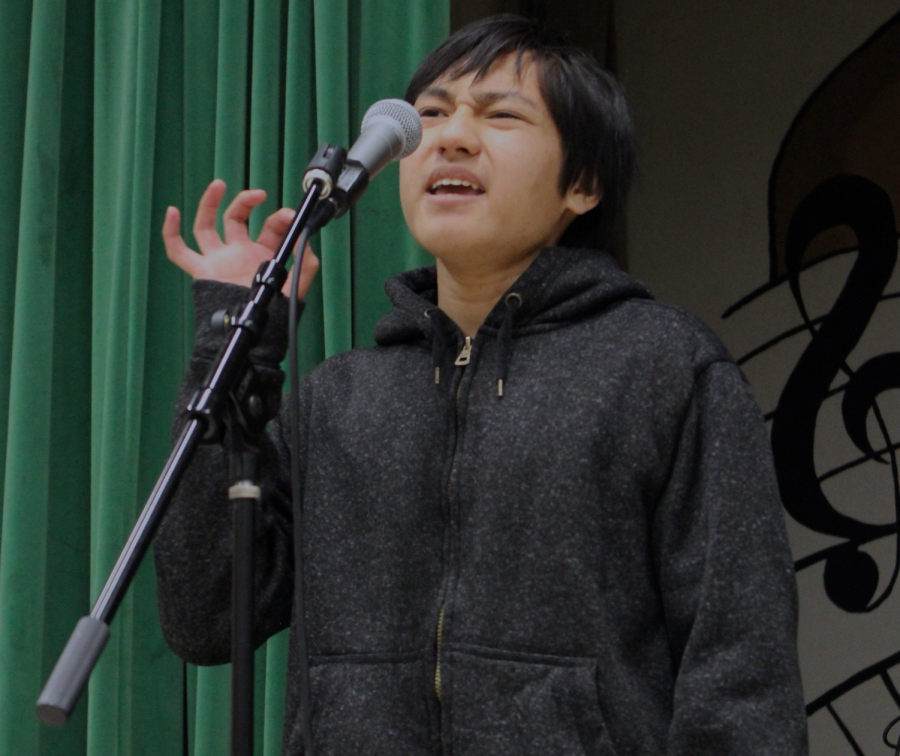 Get Lit member Justin Dumindin recites a poem during the Poetry Slam assembly on April 12 in the MPR.