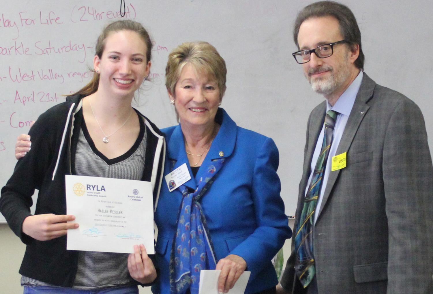 Junior Hailee Kessler receives a certificate for being selected to participate in RYLA.