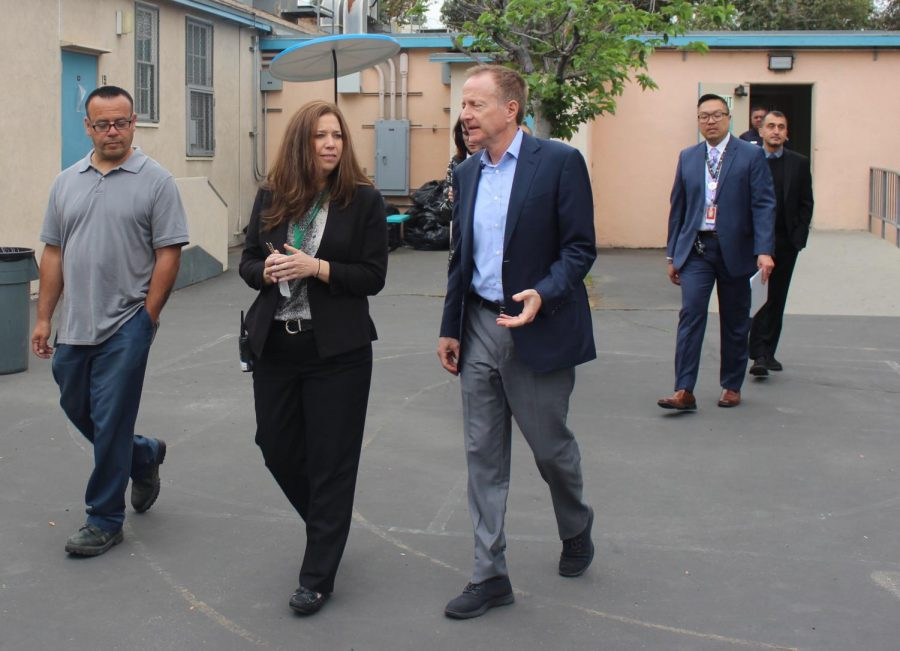 During his visit to Daniel Pearl Magnet High School on Thursday to honor district Employee of the Year Juan Amezcua (left), Superintendent Austin Beutner (right) gets a tour of the campus by Magnet Coordinator Nicole Bootel.