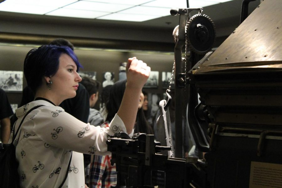 Freshman Chelsea Bangert looks at a linotype, a machine the L.A. Times used  in their early years.