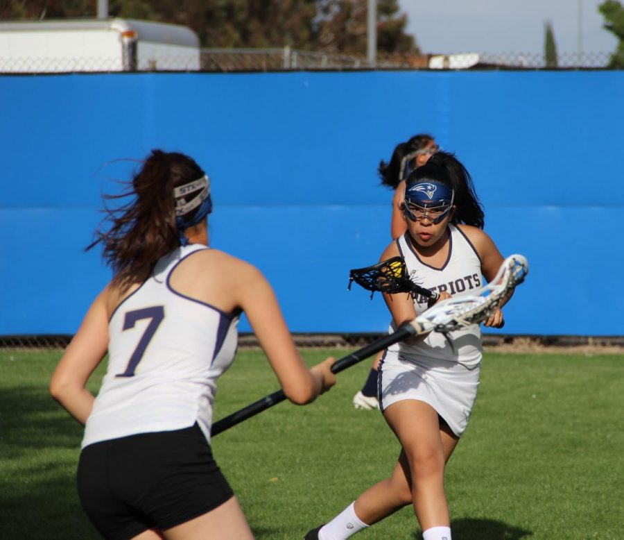 Sophomore Angie Rumbo prepares to swing her shot against an approaching defender.