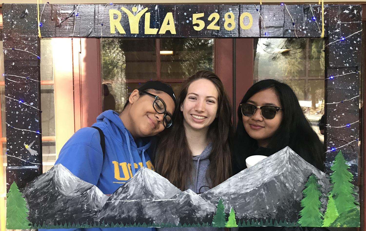 Juniors Hailee Kessler and Karina Mara pose with a friend they met at the Rotary Youth Leadership Assembly in Blue Jay, California, on April 29.
