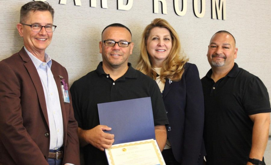 Custodian Juan Amezcua (second to the left) was awarded  the 2018 Exemplary Classified Employee of the Year at the Los Angeles Unified School District board meeting on May 8.