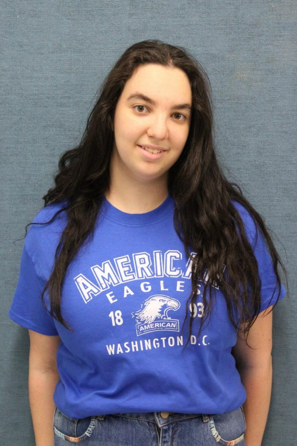 Senior Mirabelle Chernick, staff member of The Pearl Post and Prestige Yearbook, in her American University swag.