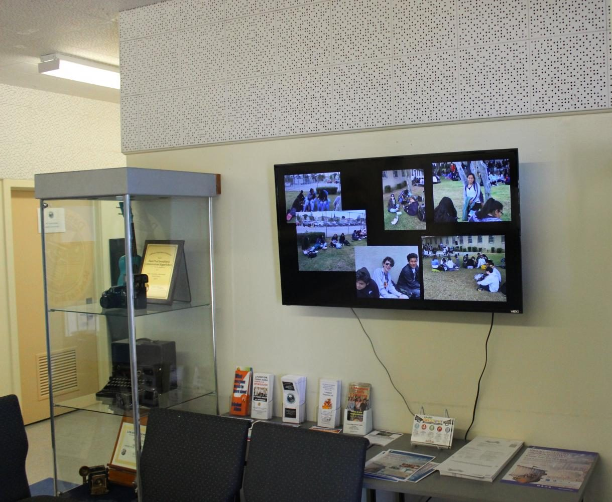 The new television is mounted on the right above the waiting area in the main office.