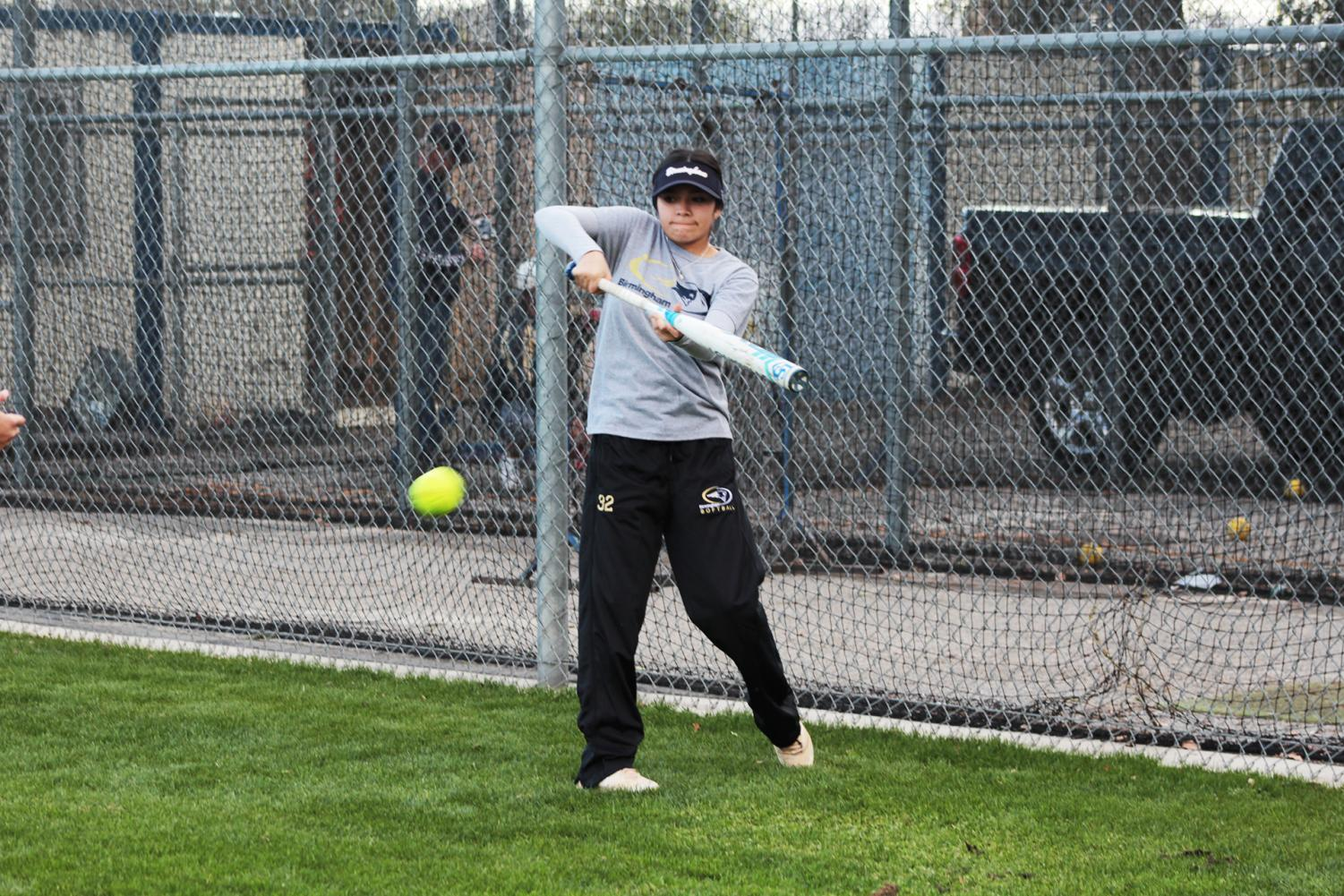 Sophomore Nattaly Villaseñor practices bunting during practice in the softball field.