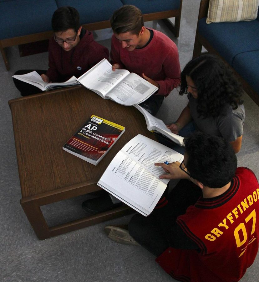 In a photo from last year, editors browse through study guides for standardized exams.