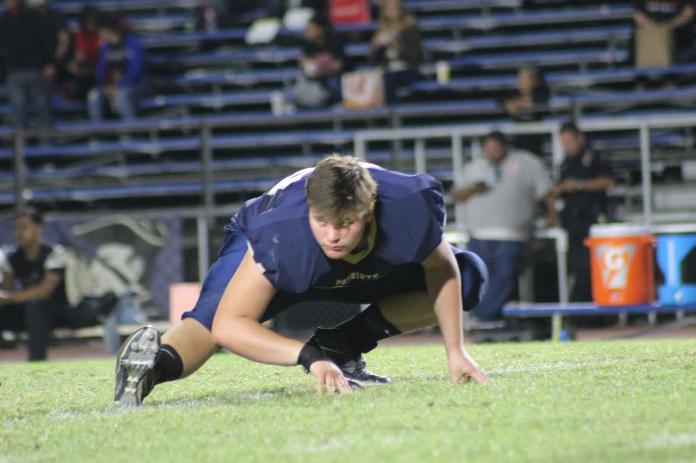 Varsity football player Kyle Matson warming up before last year's homecoming game.