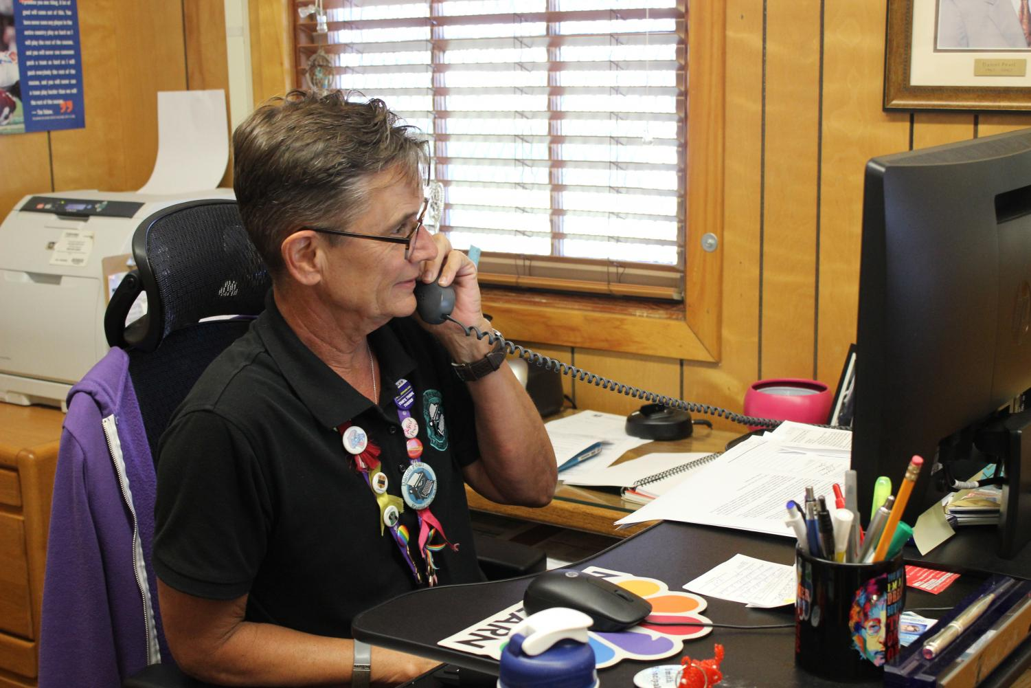 Principal Deb Smith takes a phone call during school. This year will be Smith's last year as she plans to retire.