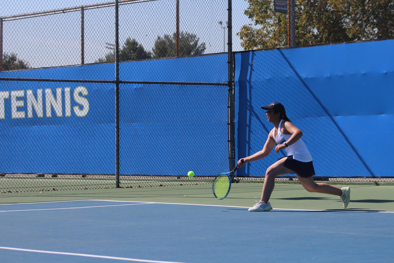 Senior+Karina+Mara+lunges+for+the+ball+during+a+match+against+John+Marshall+High+School.