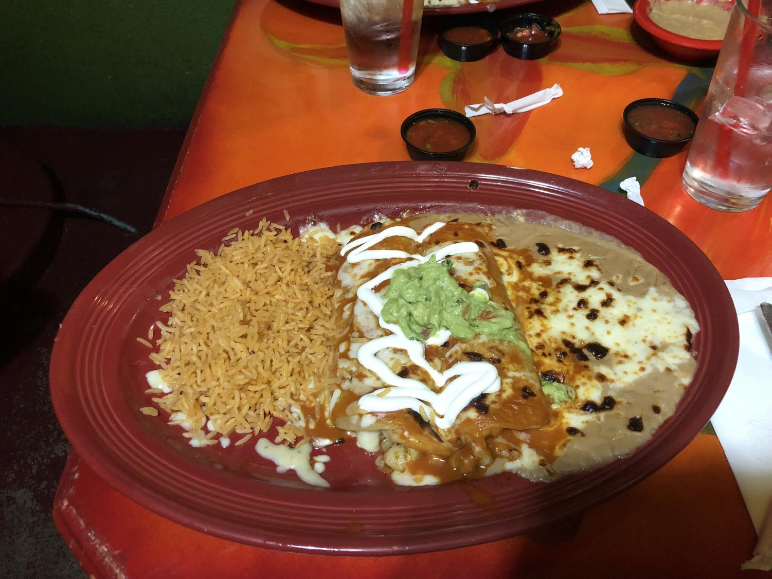Freshly made shrimp enchiladas with red sauce, refried beans and rice are among one of the many dishes offered at Salsa and Beer.