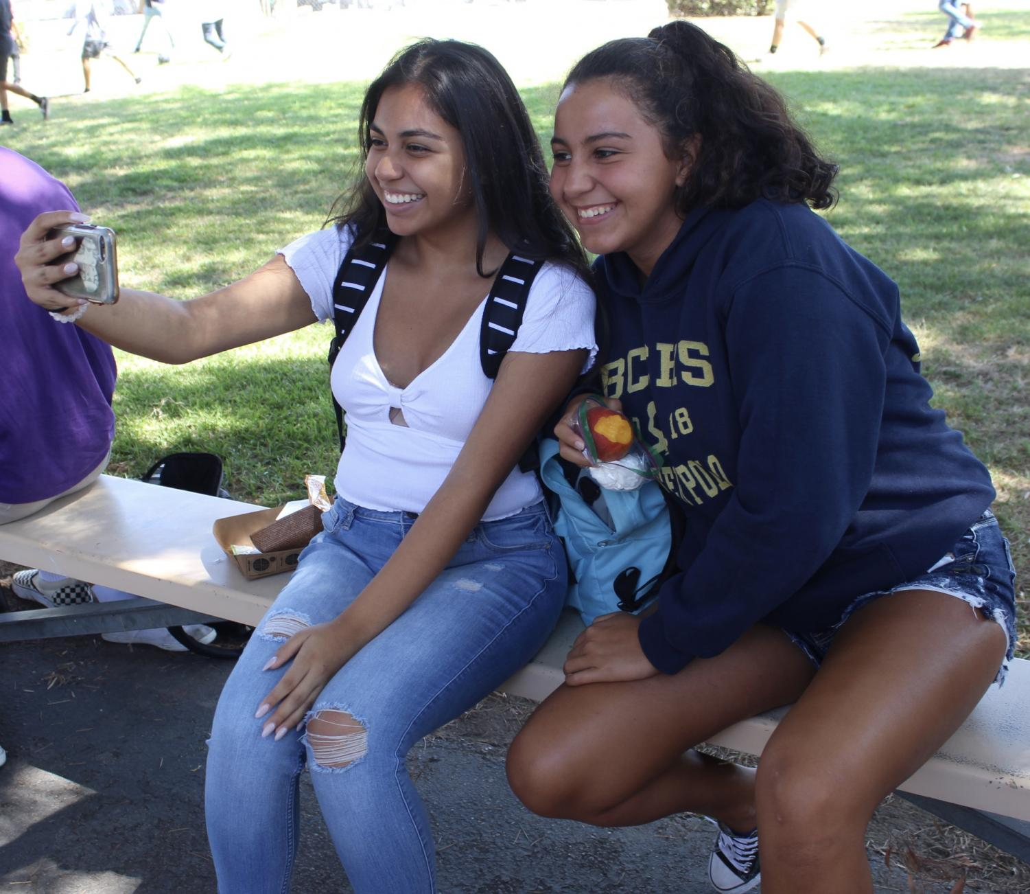 Sophomores+Sara+Marquez+and+Amelia+Sanchez+take+selfies+during+lunch+on+Sept.+13.+
