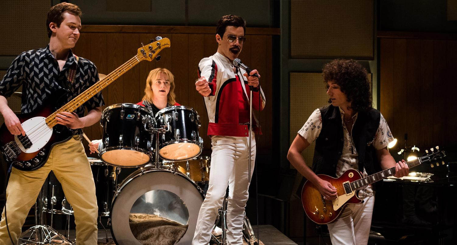 Freddie Mercury, played by Rami Malek, jams out with his band.