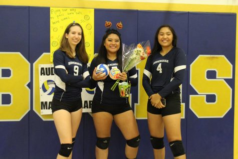 Varsity volleyball captain Hailee Kessler poses with her fellow Lady Patriots Audree Alaras and Keona Paniagua after their home game against the Toreadors October 11.