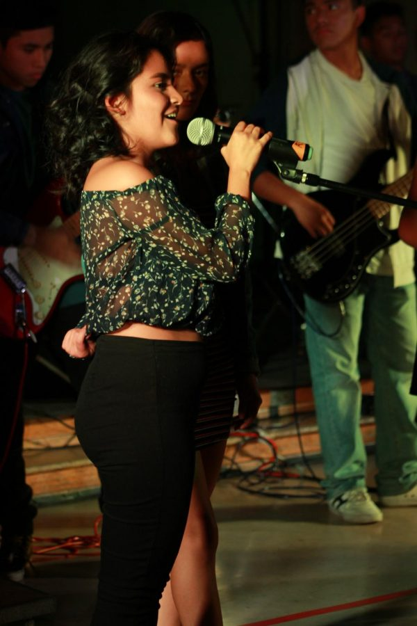 Sophomore Natalie Castillo performs Hey Jude at the Daniel Pearl World Music Day dress rehearsal on Oct. 24.