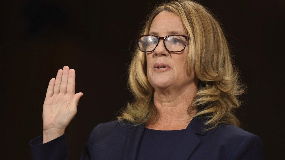 Christine Blasey Ford is sworn in to testify before the Senate Judiciary Committee.