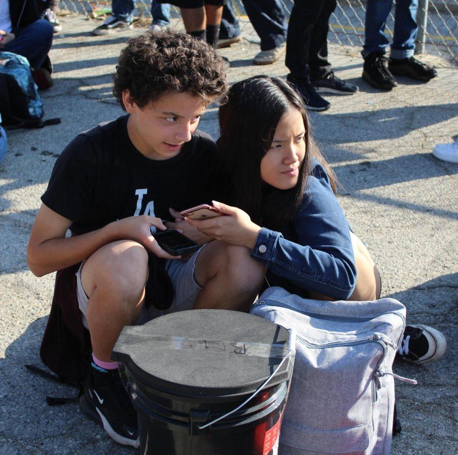 Freshmen Jaezl Bata and Ethan De Barraicua sit together during the earthquake drill on Oct. 23