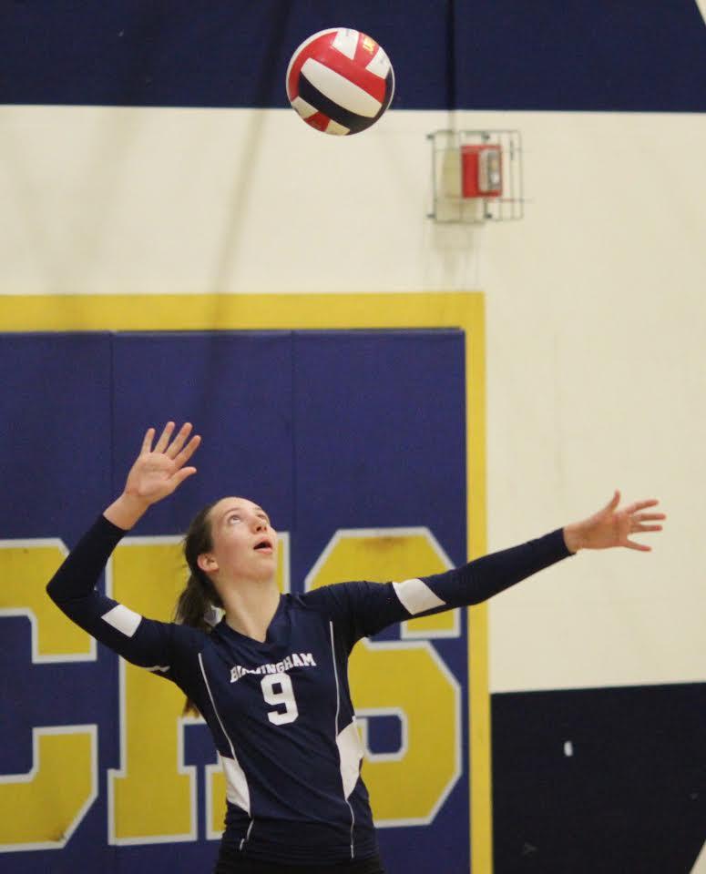 Captain Hailee Kessler serves against Cleveland High School varsity volleyball girls on Oct. 3