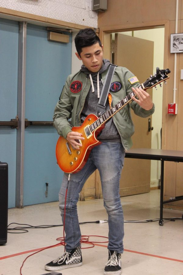 Junior+Emiliano+Cruz+plays+the+national+anthem+for+students+and+the+veterans+during+the+Veterans+Day+event+on+Nov.+9.+This+event+was+hosted+by+history+teacher+Frankie+Ortega.+