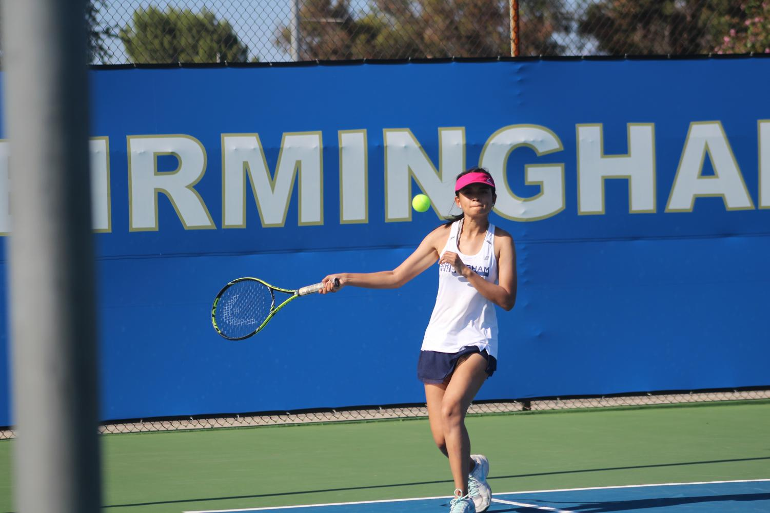 Christine Valenzuela swings her racket in her doubles match on Aug. 23 against Marshall High School.