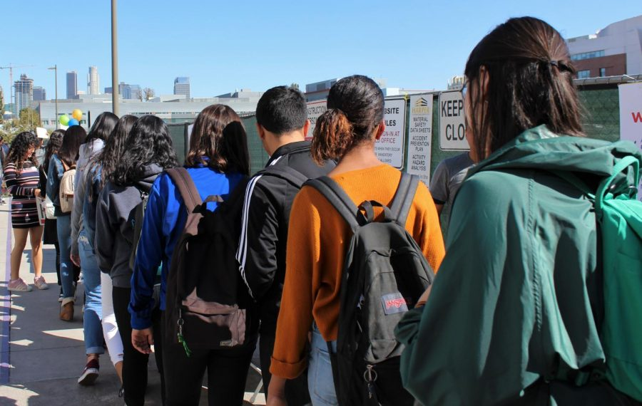 Daniel Pearl Magnet High School students wait in line to receive for bags filled with scholarship applications and other college information at the Los Angeles Cash for College event on Nov. 9.