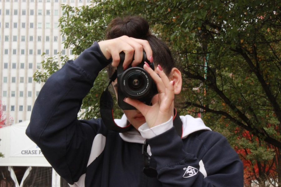 Junior Alondra Nuno takes photos during a digital photography workshop in Millennium Park on Nov. 1.