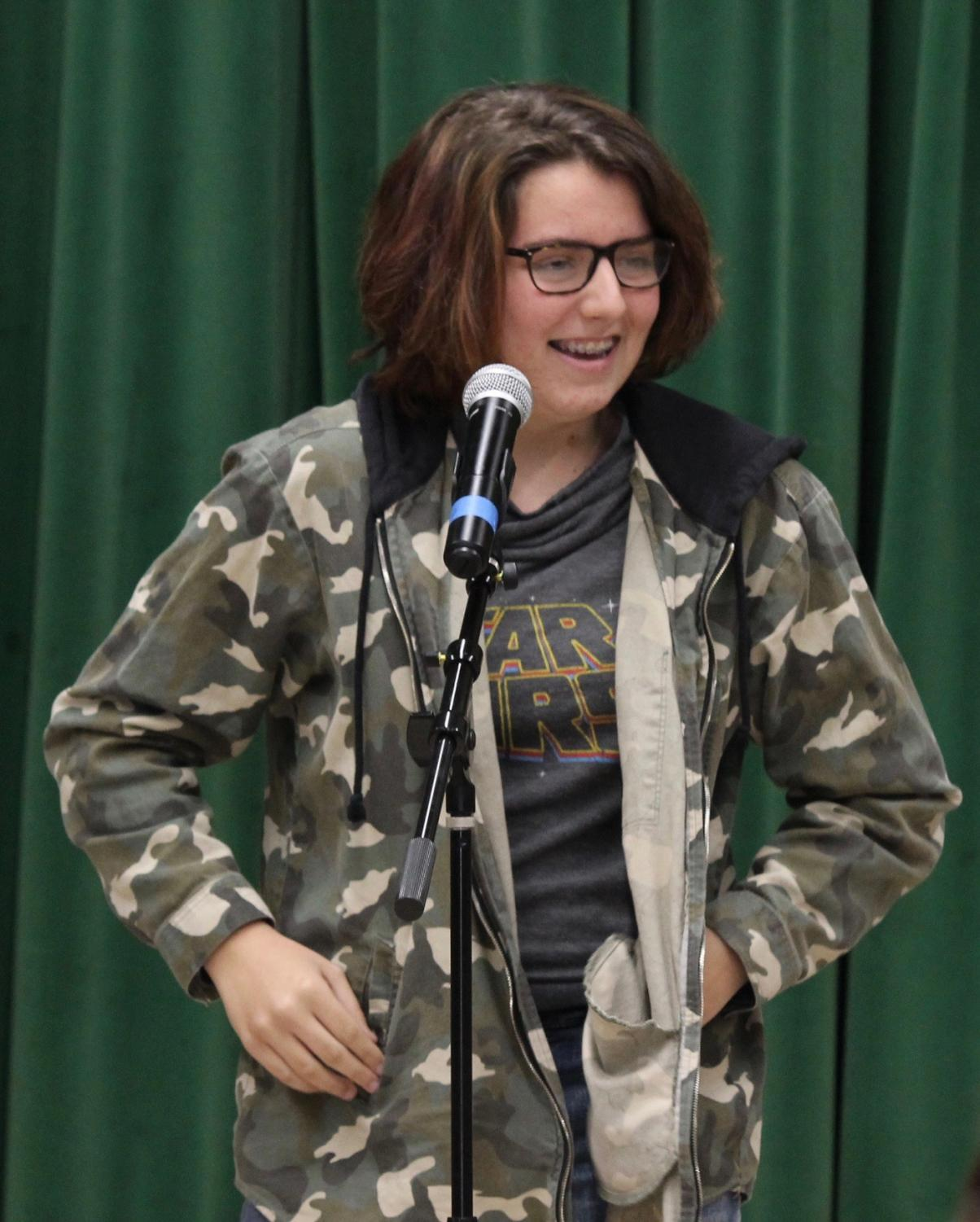 Sophomore+Stephanie+Pynes+shares+her+own+poem+at+the+Get+Lit%21+assembly+on+Nov.+15.