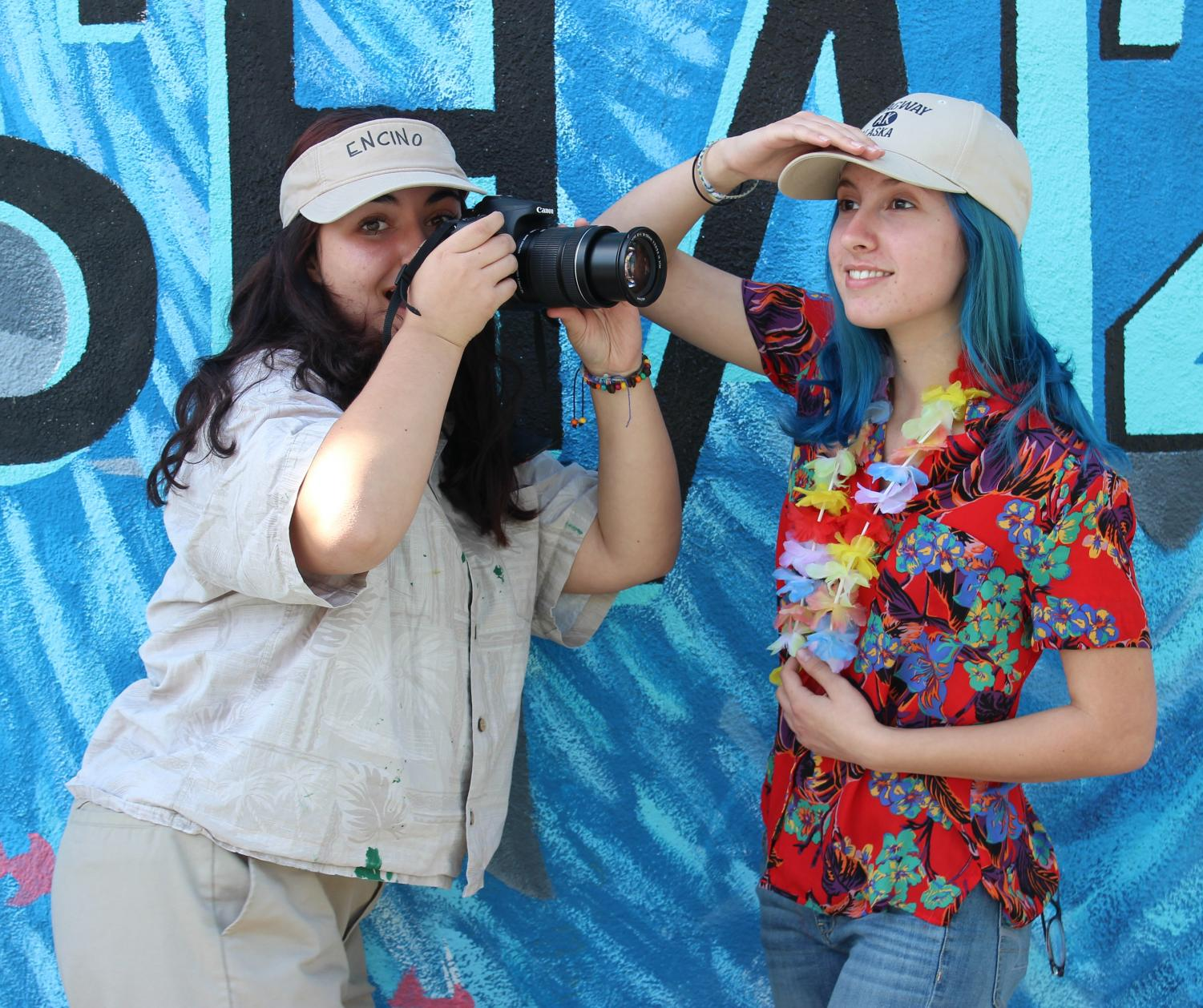 Junior Anna Equils and senior Lauryn Uhlenberg show off their spirit for Tourist Day on Nov. 1.