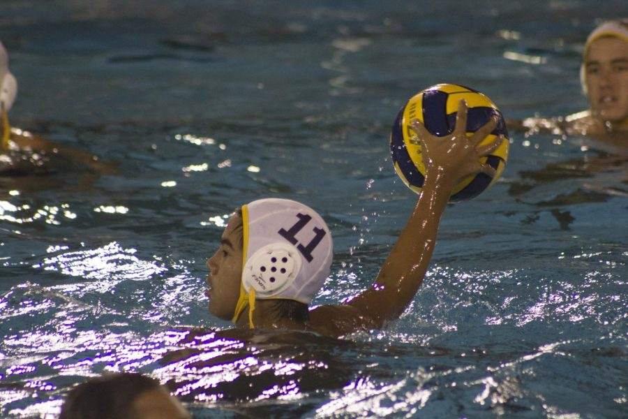 Driver CJ Gorospe passes the ball to his teammate during the CIF City Championship game on Nov. 8 at Los Angeles Valley College.