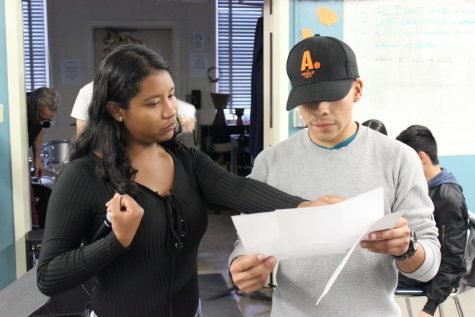 Juniors Ximena Renteria and Daniel Raymundo go over lyrics for the 2018 Winter Show.