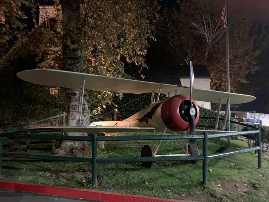 This airplane is one of many replica war planes that stands in a small field at the restaurant. As you enter the building you are greeted with this airplane as well as other replica vehicles from World War I.
